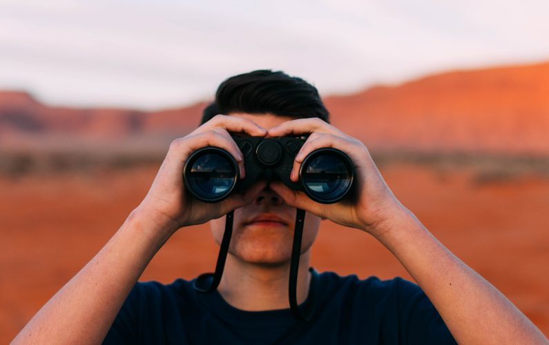 Canva - Man Looking Through Binoculars